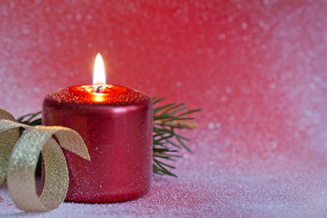 Christmas red candle closeup background concept