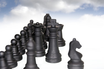 chess pieces isolated against clouds