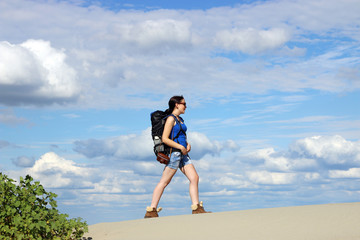 hiking in desert girl with backpack