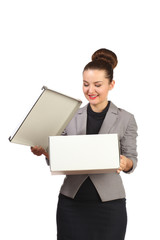 Business beautiful girl in a gray jacket opens box