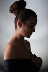Silhouette of young woman with bare shoulders