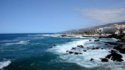 Coast of the Puerto de la Cruz city, Tenerife with big waves.