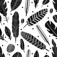 Cute seamless pattern with black feathers.