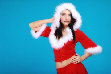 Portrait woman wearing santa clause costume on blue