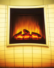 Electric artificial fireplace with orange fire flame