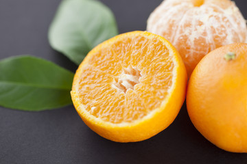 Fresh mandarines and green leaves