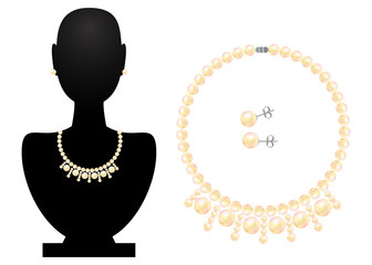 Necklace and earrings on black bust