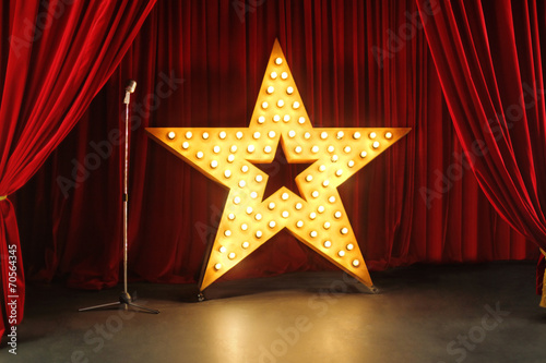Fotobehang Theater Scene with red curtains and big star with lights