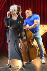 singer and man with contrabass performed in variety