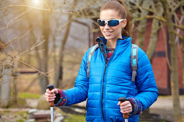 Autumn Nordic walking - active woman exercising outdoor