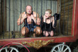 Athlete and actress sit on their knees behind bars in cage