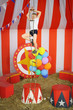 Little boy rises top rope ladder in striped circus tent