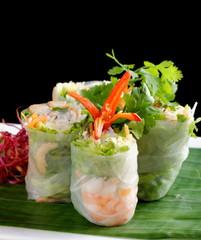 Vietnamese salad rolls with shrimps, chicken, herbs