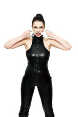 Woman in latex catsuit bite handcuffs