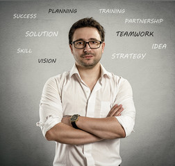 Young man in eyeglasses with elements of success in business