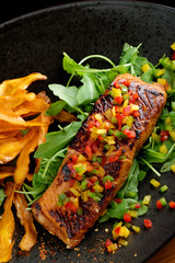 Fried fillet of red fish salmon with roasted vegetables, potato