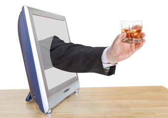whisky glass in businessman hand leans out TV