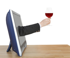red wine glass in businessman hand leans out TV