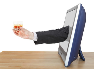 whiskey glass in businessman hand leans out TV