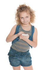 Smiling little girl with a cell phone