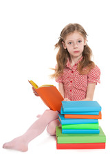 Serious young girl reads book