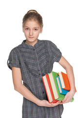 Clever young girl holds books