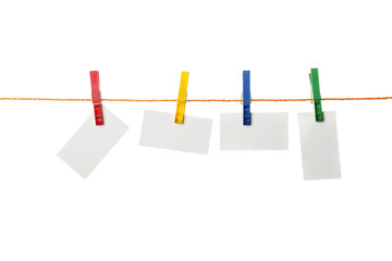 white paper attached clothespins on rope