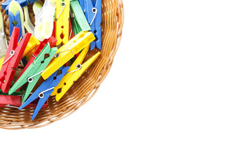 colored clothespins pegs in basket