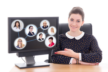 social network concept - business woman sitting in office and sh