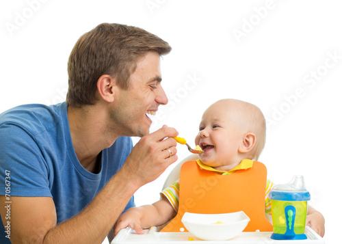 smiling baby eating food - 70567347