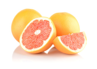 Studio shot sliced some grapefruits isolated white