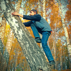 Teenager climb on the Tree