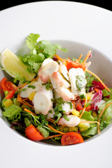 octopus salad with lemon slice lettuce and potatoes