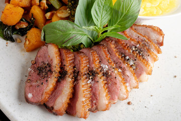 Duck breasts with sour mango sauce and pan-seared sweet potatoes