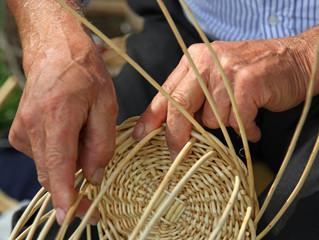 hands of skilled craftsman make a wicker basket