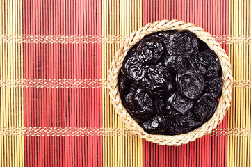 Prunes in wicker bowl