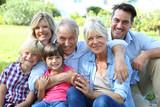Happy 3 generation family in grandparents' backyard