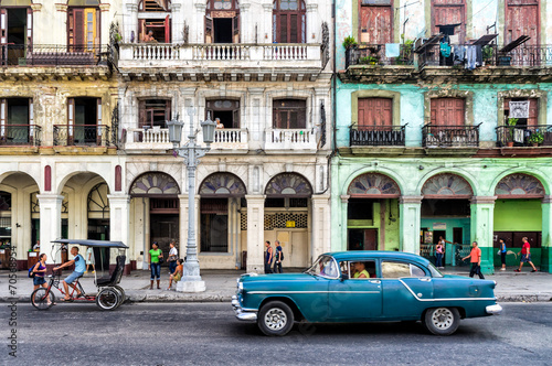 Street scene with vintage car in Havana, Cuba.