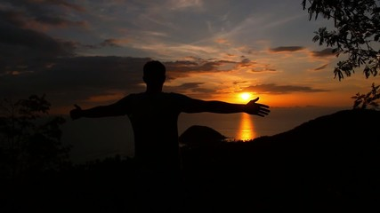 Man with Hands up at Sunset at the Top. Slow Motion.