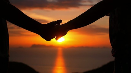 Love Couple Holding Hands at Sunset against the Sea. Slow Motion