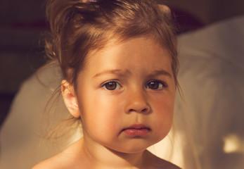 vintage portrait of Cute kid with big sad eyes