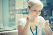 beautiful young blonde short hair hipster woman