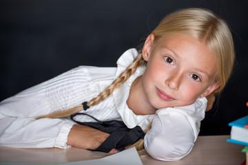 School girl resting on desk