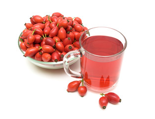 drink and rosehip berries isolated on white background