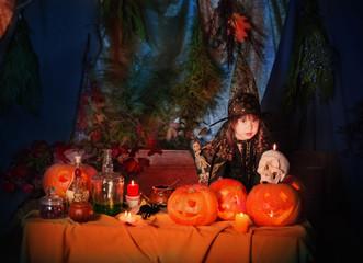 little witch with pumpkin lantern