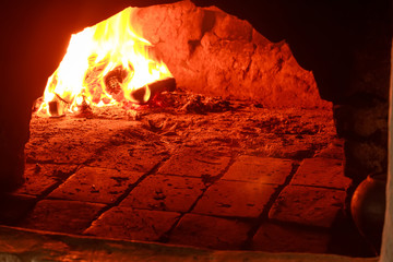 Burning wood in traditional hearth furnace