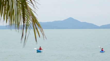 Tourist Kayaking in the Sea. Vacation in Thailand.