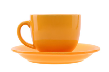 orange cup and saucer