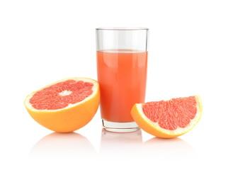 Studio shot sliced grapefruit with juice isolated on white