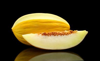 Studio shot of sliced Canary melon isolated black